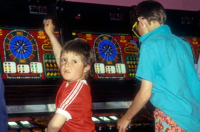 child gambling in an arcade